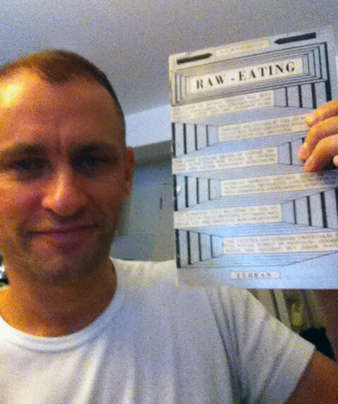 Holding_my_copy_of_Arshavir_Ter-Hovannessian's_Raw_Eating
